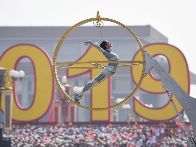 A woman performs during the National Day parade at Tiananmen Square in Beijing on October 1, 2019, to mark the 70th anniversary of the founding of the Peoples Republic of China. (Photo by Greg BAKER / AFP) (Photo credit should read GREG BAKER/AFP/Getty Images)