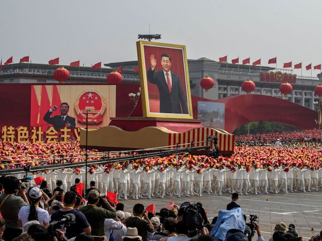 BEIJING, CHINA - OCTOBER 01: A giant portrait of Chinese President Xi Jinping is carried atop a float at a parade to celebrate the 70th Anniversary of the founding of the People's Republic of China in 1949 , at Tiananmen Square on October 1, 2019 in Beijing, China. (Photo by Kevin Frayer/Getty Images)