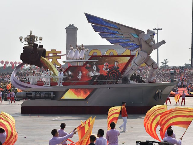 The Liaoning Province float featuring a giant winged robot passes through Tiananmen Square during a military parade in Beijing on October 1, 2019, to mark the 70th anniversary of the founding of the People's Republic of China. (Photo by GREG BAKER / AFP) (Photo credit should read GREG BAKER/AFP/Getty Images)