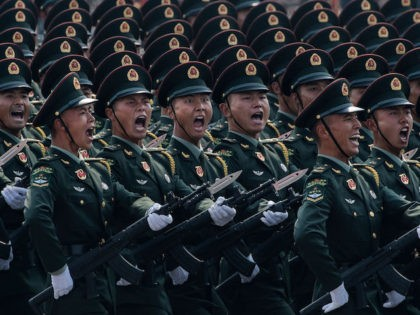 BEIJING, CHINA - OCTOBER 01: Chinese soldiers shout as they march in formation during a parade to celebrate the 70th Anniversary of the founding of the People's Republic of China at Tiananmen Square in 1949, on October 1, 2019 in Beijing, China. (Photo by Kevin Frayer/Getty Images)