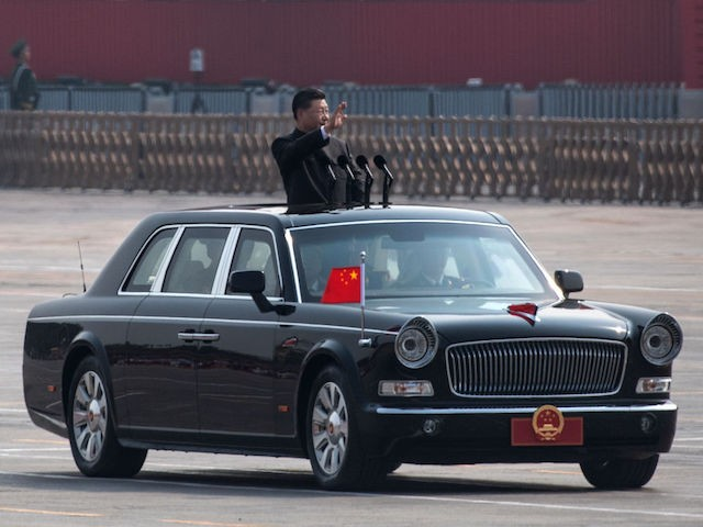 BEIJING, CHINA - OCTOBER 01: Chinese President Xi Jinping waves as he drives after inspecting the troops during a parade to celebrate the 70th Anniversary of the founding of the People's Republic of China at Tiananmen Square in 1949, on October 1, 2019 in Beijing, China. (Photo by Kevin Frayer/Getty Images)