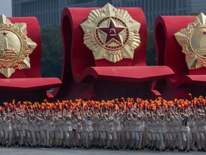 BEIJING, CHINA - OCTOBER 01: Chinese parade participants wearing communist style costume take part in a parade to celebrate the 70th Anniversary of the founding of the People's Republic of China in 1949, at Tiananmen Square on October 1, 2019 in Beijing, China. (Photo by Kevin Frayer/Getty Images)