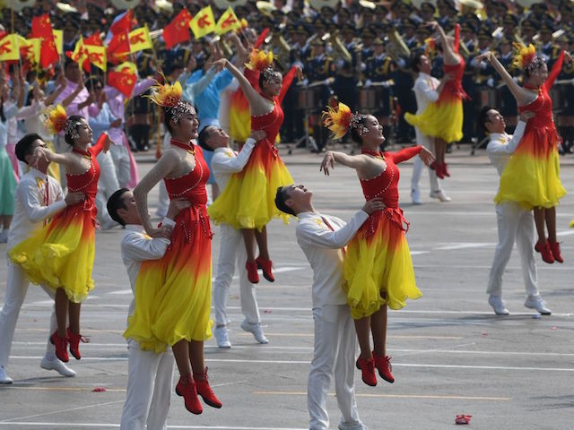Dancers perform during a military parade and celebration in Tiananmen Square in Beijing on October 1, 2019, to mark the 70th anniversary of the founding of the People's Republic of China. (Photo by GREG BAKER / AFP) (Photo credit should read GREG BAKER/AFP/Getty Images)