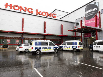 "Police cars stand on the blocked grounds of the Hermanni shopping centre in Kuopio, Finland, after an attack occurred on the premises of the Savo Vocational College on October 1, 2019. - A ""violent incident"" at a vocational college in Kuopio, eastern Finland, left one person dead and ten injured, …"