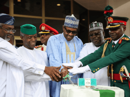 (From L) Speaker of the House of Representatives Femi Gbajabiamila, Vice President Yemi Osinbajo, Nigerian President Muhammadu Buhari and Senate President Ahmed Lawan cut an anniversary cake during a ceremony to mark the 59th anniversary of Nigeria's independence from England, on October 1, 2019 at the presidency in Abuja. (Photo …