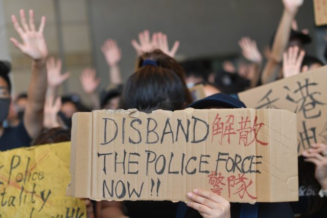 TOPSHOT - Protesters and supporters gather outside the entrance to the West Kowloon Court in Hong Kong on October 2, 2019, where some 96 protesters arrested and charged with rioting during clashes with police on September 29 were to make an appearance in court. - Spontaneous flash-mob rallies broke out …