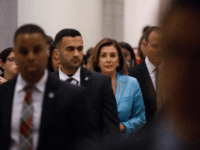 House Speaker Nancy Pelosi (D-CA) walks through a hallway amongst staff members, security, and media personnel, following a press conference with House Intelligence Committee Chairman Adam Schiff (D-CA) on October 2, 2019, on Capitol Hill in Washington, DC. Pelosi and Schiff updated members of the media on the latest developments …