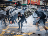 Protesters clash with police during a protest in Kowloon on October 6, 2019 in Hong Kong, China. Hong Kong's government invoked emergency powers on Friday to introduce an anti-mask law which bans people from wearing masks at public assemblies as the city remains on edge with the anti-government movement entering …