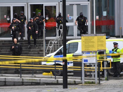 MANCHESTER, ENGLAND - OCTOBER 11: Armed police surround Arndale shopping centre, where a man allegedly stabbed five people on October 11, 2019 in Manchester, England. A man in his 40s was arrested on suspicion of assault, as paramedics treated five people for stab wounds at Manchester Arndale, a large shopping …