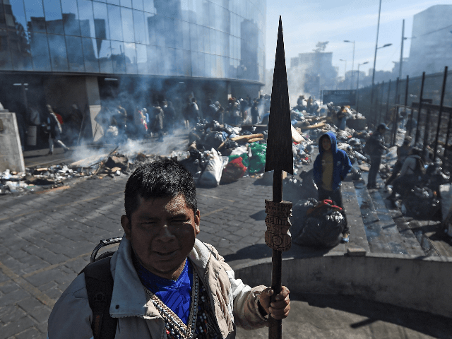 Indigenous people clean the Casa de la Cultura in Quito, on October 14, 2019, after Ecuador's president and indigenous leaders reached an agreement to end violent protests. - Ecuador's president and indigenous leaders reached an agreement to end nearly two weeks of violent protests against austerity measures put in place …