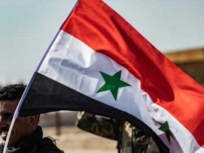 Syrian government forces arrive in the town of Tal Tamr, not far from the flashpoint Kurdish Syrian town of Ras al-Ain on the border with Turkey, which has been a key target of Turkish forces and their proxies since they launched their military assault, on October 15, 2019. - Syrian …