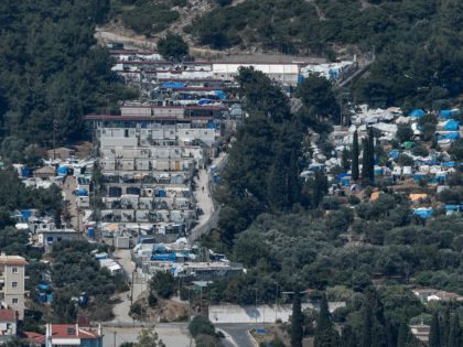 This picture taken on June 19, 2019, shows the Samos hotspot and makeshift migrant camp on the island of Samos. - At least three people were hurt in a clash between asylum-seekers in crammed Greek migrant camp that was later partly destroyed in a fire, officials said on October 15, …