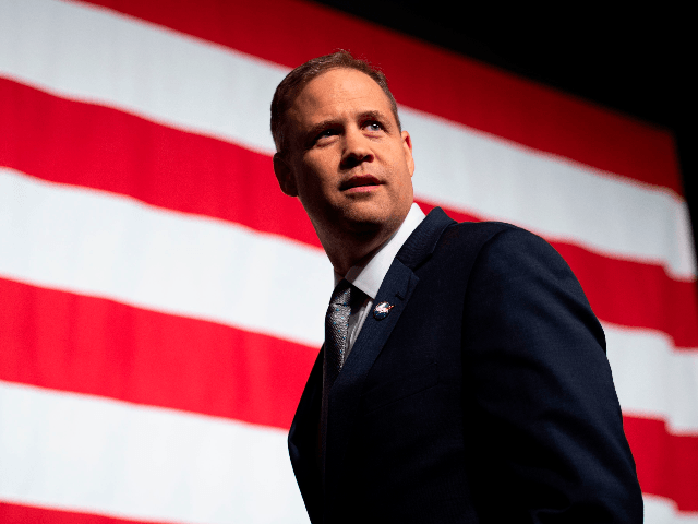 NASA administrator Jim Bridenstine looks back before a press conference displaying the next generation of space suits as parts of the Artemis program in Washington, DC on October 15, 2019. (Photo by Andrew CABALLERO-REYNOLDS / AFP) (Photo by ANDREW CABALLERO-REYNOLDS/AFP via Getty Images)
