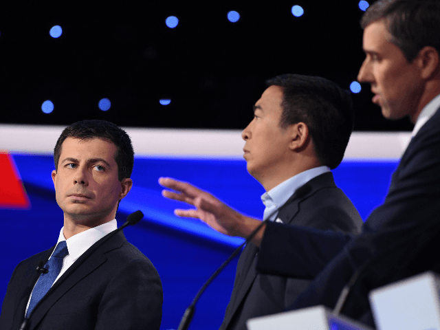 Democratic presidential hopeful Mayor of South Bend, Indiana Pete Buttigieg (L) looks on as former Texas representative Beto O'Rourke speaks during the fourth Democratic primary debate of the 2020 presidential campaign season co-hosted by The New York Times and CNN at Otterbein University in Westerville, Ohio on October 15, 2019. …