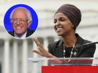 "(INSET: Bernie Sanders) WASHINGTON, DC - SEPTEMBER 26: Rep. Ilhan Omar (D-MN) speaks at the ""Impeachment Now!"" rally in support of an immediate inquiry towards articles of impeachment against U.S. President Donald Trump on the grounds of the U.S. Capital on September 26, 2019in Washington, DC. (Photo by Paul Morigi/Getty …"
