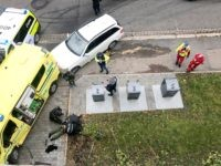 TOPSHOT - A man is arrested by the police after hijacking an ambulanse in Oslo on October 22, 2019 in Oslo, Norway. - Norwegian police arrested an armed man who, according to media reports, went on the rampage in Oslo inthe stolen ambulance, running down pedestrians including a baby in …