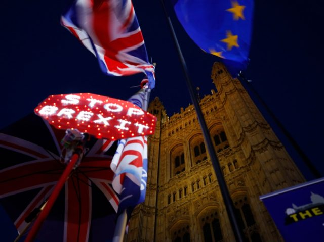 Banners, Union and EU flags are displayed outside the Houses of Parliament in London on October 22, 2019, as MPs debate the second reading of the Government's European Union (Withdrawal Agreement) Bill. - British Prime Minister Boris Johnson faces two crucial Brexit votes Tuesday that could decide if he still …