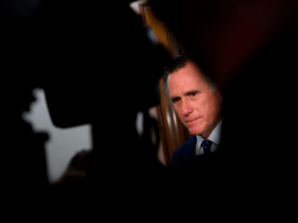 US Senator Mitt Romney (R-UT) speaks with reporters after a hearing on Capitol Hill in Washington, DC on October 22, 2019. (Photo by Andrew CABALLERO-REYNOLDS / AFP) (Photo by ANDREW CABALLERO-REYNOLDS/AFP via Getty Images)