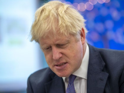 Britain's Prime Minister Boris Johnson speaks to pupils as he visits Middleton Primary School in Milton Keynes, southern England on October 25, 2019. - UK Prime Minister Boris Johnson on October 24 proposed settling the Brexit crisis through an early election on December 12 that could help Britain finally find …