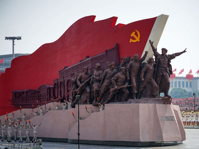 BEIJING, CHINA - OCTOBER 01: A float featuring the hammer and sickle is seen during a parade to celebrate the 70th Anniversary of the founding of the People's Republic of China in 1949, at Tiananmen Square on October 1, 2019 in Beijing, China. (Photo by Andrea Verdelli/Getty Images)