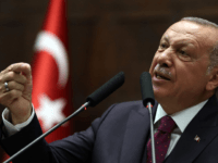 President of Turkey and leader of Turkey's ruling Justice and Development (AK) Party Recep Tayyip Erdogan gestures as he delivers a speech during his party's parliamentary group meeting at the Grand National Assembly of Turkey (TBMM) in Ankara, on October 30, 2019. (Photo by Adem ALTAN / AFP) (Photo by …