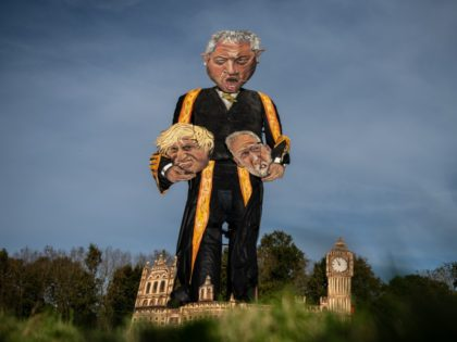 EDENBRIDGE, ENGLAND - OCTOBER 30: The Edenbridge Bonfire Society's 2019 'Celebrity Guy', Speaker of the House of Commons John Bercow, is erected after initially breaking during the unveiling on October 30, 2019 in Edenbridge, England. The 11 meter tall effigy, created by artist Andrea Deans, depicts Mr Bercow holding the …