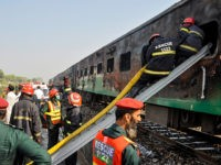 Firefighters work to cool down the burnt-out train carriages after a passenger train caught on fire near Rahim Yar Khan in Punjab province on October 31, 2019. - At least 71 people were killed and dozens injured after cooking gas cylinders exploded on a train packed with pilgrims in Pakistan …