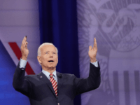 Democratic U.S. presidential candidate and former Vice President Joe Biden gestures to the crowd at the Human Rights Campaign Foundation and CNN's presidential town hall, focused on LGBTQ issues, on October 10, 2019 in Los Angeles, California. It is the first Presidential event broadcast on a major news network focused …