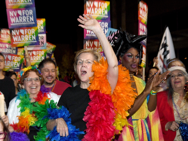 Democratic presidential candidate and U.S. Sen. Elizabeth Warren (D-MA) (C) and drag queen Shea Coulee (2nd R) march in the Southern Nevada Association of Pride Inc. 22nd annual PRIDE Night Parade on October 11, 2019 in Las Vegas, Nevada. Recent national presidential primary polls show Warren in a tight race …