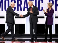 WESTERVILLE, OHIO - OCTOBER 15: Sen. Bernie Sanders (I-VT), former Vice President Joe Biden, and Sen. Elizabeth Warren (D-MA) enter the stage before the Democratic Presidential Debate at Otterbein University on October 15, 2019 in Westerville, Ohio. A record 12 presidential hopefuls are participating in the debate hosted by CNN …