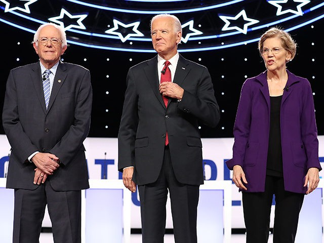 WESTERVILLE, OHIO - OCTOBER 15: Democratic presidential candidates (L-R) Sen. Bernie Sanders (I-VT), former Vice President Joe Biden, Sen. Elizabeth Warren (D-MA) and South Bend, Indiana Mayor Pete Buttigieg at the start of the Democratic Presidential Debate at Otterbein University on October 15, 2019 in Westerville, Ohio. A record 12 …