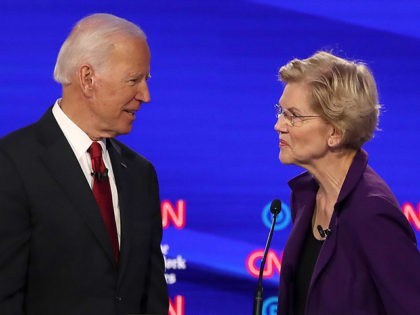 WESTERVILLE, OHIO - OCTOBER 15: Former Vice President Joe Biden and Sen. Elizabeth Warren (D-MA) react during a break at the Democratic Presidential Debate at Otterbein University on October 15, 2019 in Westerville, Ohio. A record 12 presidential hopefuls are participating in the debate hosted by CNN and The New …