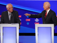 Sen. Bernie Sanders (I-VT) and former Vice President Joe Biden interact during the Democratic Presidential Debate at Otterbein University on October 15, 2019 in Westerville, Ohio. A record 12 presidential hopefuls are participating in the debate hosted by CNN and The New York Times. (Photo by Win McNamee/Getty Images)