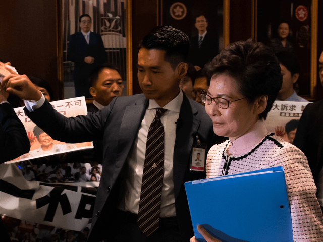 Hong Kong's Chief Executive Carrie Lam walks into the chamber to give her annual policy address at the Legislative Council on October 16, 2019 in Hong Kong, China. Anti-government demonstrations in Hong Kong stretched into its fifth month after the Chinese territory's government invoked emergency powers earlier this month to …