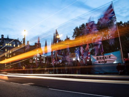 LONDON, ENGLAND - OCTOBER 29: Supporters and critics of Brexit are seen through the trails of car lights as they protest opposite the Houses of Parliament on October 29, 2019 in London, England. Prime Minister Boris Johnson has put forward a motion for a short bill proposing an early general …