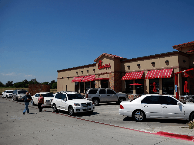 """Drive through customers wait in line at a Chick-fil-A restaurant on August 1, 2012 in Fort Worth, Texas. Chick-fil-A resturants across the country experienced heavier than normal traffic after Mike Huckabee, the former governor of Arkansas and a 2008 presidential candidate, encouraged a """"Chick-fil-A Appreciation Day"""" in support of the …"""