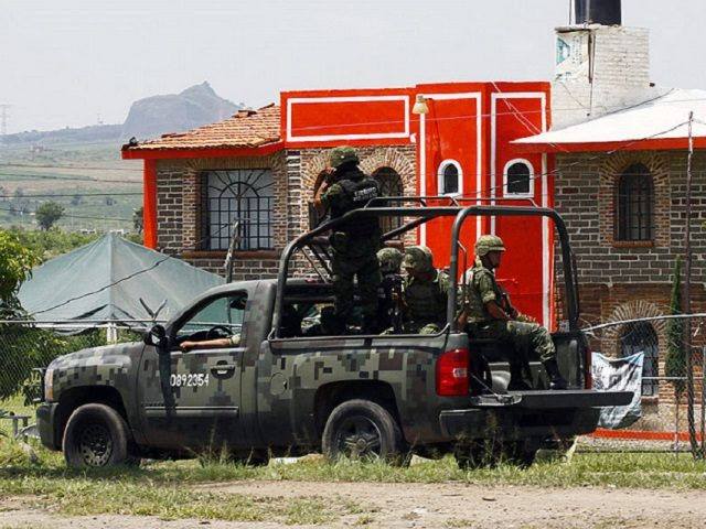 Members of the Army patrol the surroundings of the Puente Grande State prison in Zapotlanejo, Jalisco State, Mexico, on 9 August, 2013 where former top Mexican cartel boss Rafael Caro Quintero -- who masterminded the kidnap and murder of a US anti-drug agent in 1985 -- was informed early Friday …