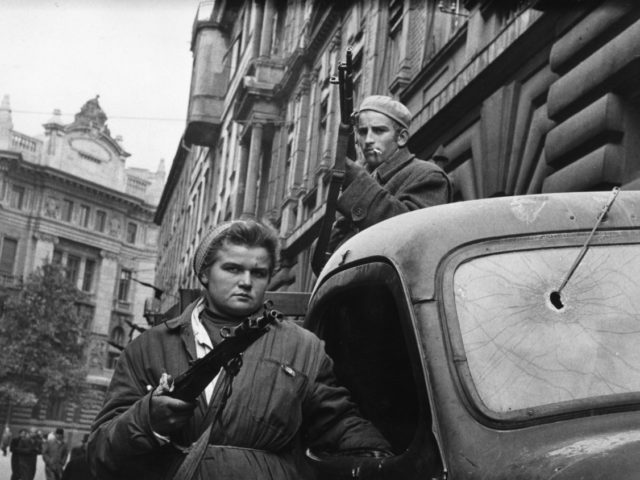 12th November 1956: A couple of Hungarian freedom fighters bearing arms in Budapest, in preparation for the Russian forces. Original Publication: Picture Post - 8730 - Hungary's Last Battle For Freedom - pub. 1956 (Photo by Jack Esten/Picture Post/Hulton Archive/Getty Images)