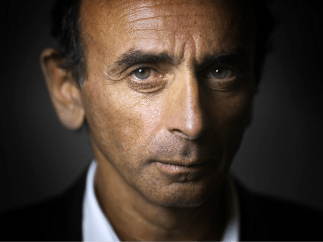 """French journalist and writer Eric Zemmour poses at his office in Paris on January 12, 2015. The polemicist and tv commentator's last book entitled """"Le Suicide Français"""" (The French suicide), which was released in October 2014, is a best-seller. In an interview given to Italian newspaper Corriere della Sera in …"""