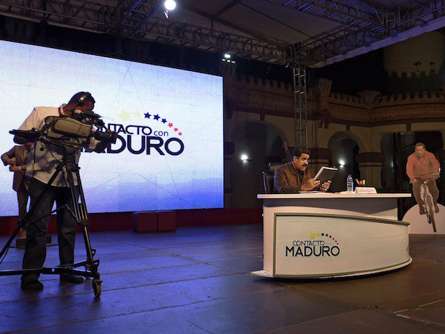 "Venezuelan President Nicolas Maduro speaks during his TV program called ""Contacto con Maduro"" (Contact with Maduro) in Caracas on October 6, 2015. Maduro said Tuesday that the absence of Chavez and what he denounces as an ""economic war"" make the upcoming legislative elections the most complicated so far for the …"