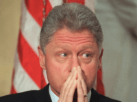 US President Bill Clinton listens during ceremonies for former Agriculture Secretary Mike Espy 10 December at the Agriculture Department in Washington, DC. While Clinton attends to business as usual, Democratic Counsel Abbe Lowell is arguing against impeaching Clinton for allegedly lying about obstucting justice in the Monica Lewinsky affair at …