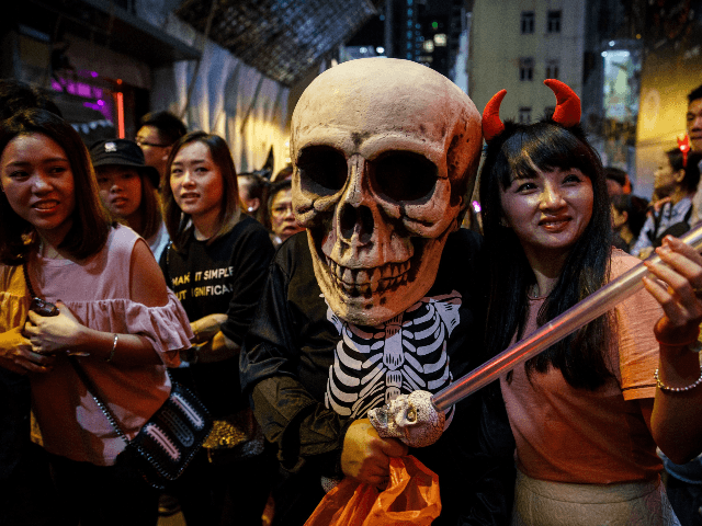People celebrate Halloween in Hong Kong on October 31, 2016. / AFP / Anthony WALLACE (Photo credit should read ANTHONY WALLACE/AFP via Getty Images)