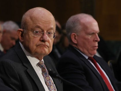 WASHINGTON, DC - JANUARY 10: FBI Director James Comey, Director of National Intelligence James Clapper and Central Intelligence Agency Director John Brennan (L-R) testify before the Senate (Select) Intelligence Committee in the Dirksen Senate Office Building on Capitol Hill January 10, 2017 in Washington, DC. The intelligence heads testified to …