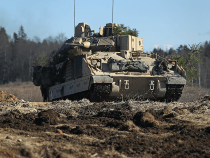 A US Army M2A3 Bradley fighting vehicle of Chaos Company, 1-68 Armor Battalion of the 3rd Brigade Combat Team, 4th Infantry Division, attacks an enemy position during a joint military combat exercise with Estonian soldiers on March 23, 2017 near Tapa, Estonia. Troops of the US Army 4th Infantry Division, …