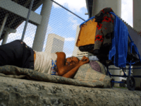 Belede Martinez, who is homeless, sleeps November 20, 2001 on a sidewalk in Miami, Florida. Nearly one third of the city's population - 32 percent of residents - lives in poverty, a greater percentage than in any other city of 250,000 or more, the US Census survey indicates. (Photo by …