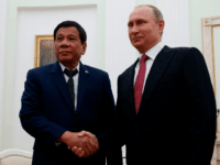 Russian President Vladimir Putin (R) shakes hands with his Philippine counterpart Rodrigo Duterte during a meeting in Moscow late on May 23, 2017. / AFP PHOTO / POOL / MAXIM SHEMETOV (Photo credit should read MAXIM SHEMETOV/AFP/Getty Images)