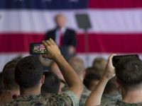 SIGONELLA, ITALY - MAY 27: In this handout provided by U.S. Navy, A Marine records President Donald J. Trump remarks during an all-hands call with service members and their families at Naval Air Station Sigonella May 27, 2017 in Sigonella, Italy. This visit marks President Trump's last stop of his …