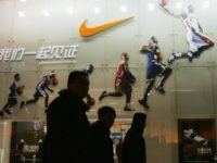 BEIJING - DECEMBER 26: People pass by the Nike shop on December 26, 2007 in Beijing, China. The Beijing Olympic Games will bring enormous commercial opportunity to Beijing. (Photo by Feng Li/Getty Images)