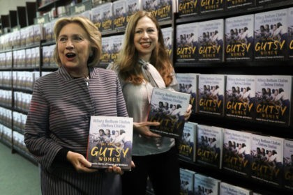 "NEW YORK, NEW YORK - OCTOBER 03: Chelsea and Hillary Clinton pose with their new book ""The Book of Gutsy Women"" on October 03, 2019 in New York City. The new book by mother and daughter co-authors celebrates women in history, many of whom have been overlooked, that have stood …"