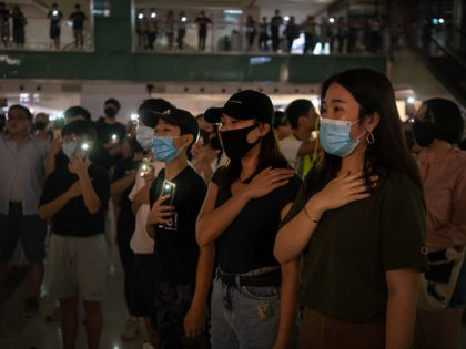 HONG KONG, CHINA - OCTOBER 12: Pro-democracy protesters sing a protest anthem during a rally at a shopping mall in Shatin district on October 12, 2019 in Hong Kong, China. Hong Kong's government invoked emergency powers on Friday to introduce an anti-mask law as protesters marked the 70th anniversary of …
